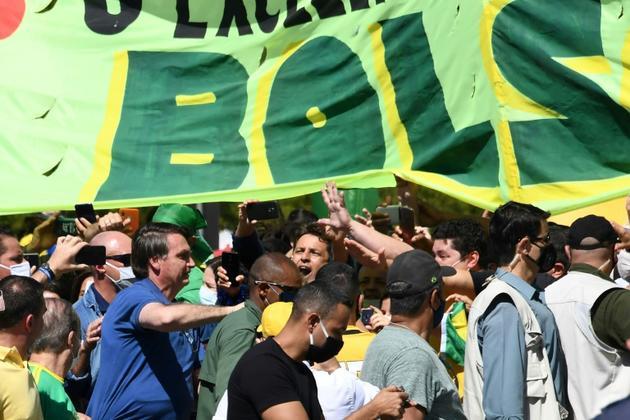 Le président brésilien Jair Bolsonaro lors d'un rassemblement avec ses partisans, le 31 mai 2020 à Brasilia [EVARISTO SA / AFP]