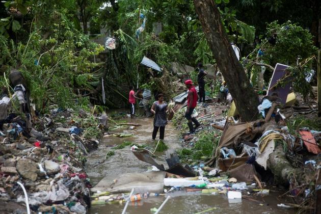 Une inondation en raison de la tempête Isaias dans la ville de Hato Mayor, au nord-ouest de Saint-Domingue, en République dominicaine, le 31 juillet 2020 [Erika SANTELICES / afp/AFP]