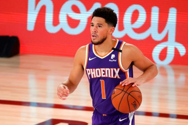 Devin Booker, auteur de 35 points lors de la victoire de Phoenix face aux Los Angeles Clippers [Kevin C. Cox / GETTY IMAGES NORTH AMERICA/AFP]